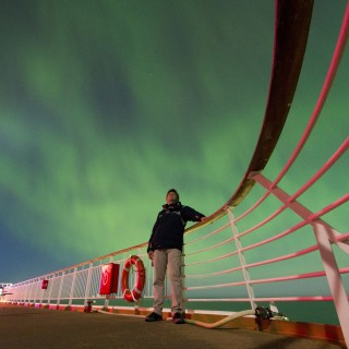 After experiencing days with cloudy skies, the sky cleared and we were lucky to see the most amazing Aurora Borealis, here photographed from the sun deck of M/S Trollfjord. Although it was a challenge to capture it from a moving ship!